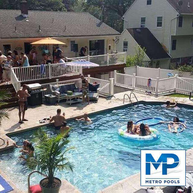 Family enjoying their time by the vinyl liner inground swimming pool Passaic County NJ Metropools